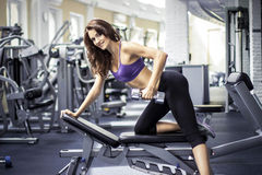 This is fitness girl with dumbbells Royalty Free Stock Photography