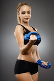 Fitness girl with dumbbells Stock Photo