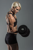 Fitness girl with dumbells Royalty Free Stock Photo
