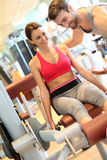 Fitness girl excercising with coach in a fitness center Royalty Free Stock Photography