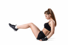Fitness girl during exercise to strengthen and tone up the entire abdominal wall. stock images
