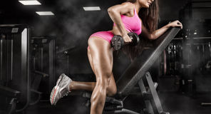 Fitness girl exercising with barbell in gym Royalty Free Stock Photos