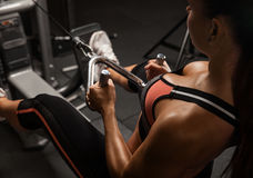 Fitness girl exercising with barbell in gym Stock Photo