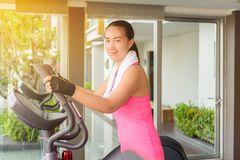 Fitness girl exercising on a cardio machine Royalty Free Stock Image
