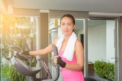Fitness girl exercising on a cardio machine Royalty Free Stock Photos