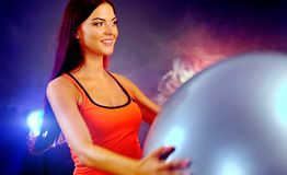 Fitness girl exercising in gym with fitball. Royalty Free Stock Photos