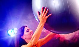 Fitness girl exercising in gym with fitball. Stock Image