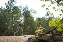 Fitness girl exercising in nature. Image of attractive fitness girl exercising in nature Royalty Free Stock Images