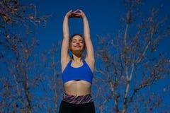Fitness girl exercising outdoors stock photos