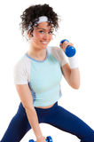 Fitness girl Exercising with weights, smiling Royalty Free Stock Photography