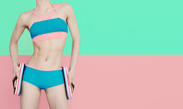 Fitness girl in fashionable sports swimsuit Stock Photography