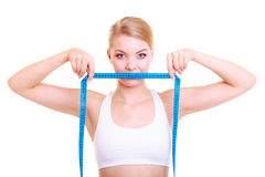 Fitness girl fit woman covering her mouth with measuring tape Stock Images