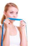 Fitness girl fit woman covering her mouth with measuring tape Royalty Free Stock Photos