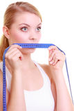 Fitness girl fit woman covering her mouth with measuring tape Royalty Free Stock Photography