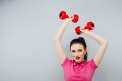Fitness girl fit woman with dumbbells, doing exercise with dumb bells training with weights isolated on white background Royalty Free Stock Images