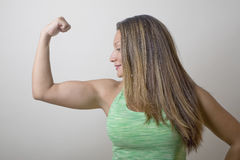 Fitness Girl Flexing Muscles Royalty Free Stock Photography