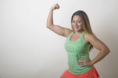 Fitness Girl Flexing Muscles Royalty Free Stock Photos