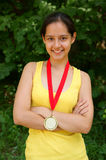 Fitness girl with gold medal Stock Photography