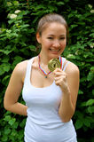 Fitness girl with gold medal outdoor Stock Images
