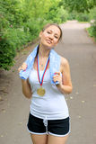Fitness girl with gold medal outdoor Royalty Free Stock Photos