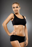 Fitness girl on gray background Stock Photography