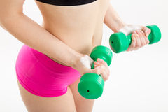 Fitness girl with green dumbbells Stock Image