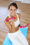 Fitness girl in gym Stock Photography