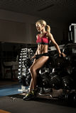 Fitness girl in gym Stock Images