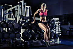 Fitness girl in gym Stock Image