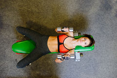 Fitness girl at the gym with dumbbells. The concept of health, sports Royalty Free Stock Photo