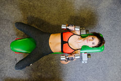 Fitness girl at the gym with dumbbells. The concept of health, sports Royalty Free Stock Photos