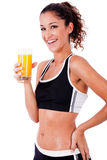 Fitness girl having fresh juice in hand Royalty Free Stock Photo