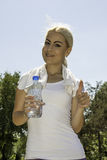 Fitness girl holding bottle of water. Portrait of fitness girl holding bottle of water royalty free stock photography