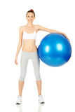 Fitness girl holding exercising ball Royalty Free Stock Images