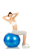 Fitness girl holding exercising ball Royalty Free Stock Photography