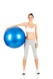Fitness girl holding exercising ball Royalty Free Stock Photos