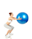 Fitness girl holding exercising ball Stock Photos