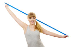 Fitness girl holds measure tape, measuring her body Royalty Free Stock Images