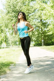 Fitness girl jogging Stock Photo