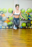Fitness girl with jumping rope. In the fitness room. The concept of health, sports Stock Photo