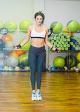 Fitness girl with jumping rope. In the fitness room. The concept of health, sports Stock Photos