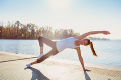 Fitness girl at lake Stock Images