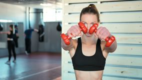 Fitness girl lifting dumbbell in the gym.  stock video footage