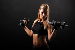 Fitness,girl lifting weights Stock Photo