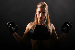 Fitness,girl lifting weights Royalty Free Stock Photography