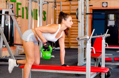 Fitness girl lifting weights in the modern gym Royalty Free Stock Photos
