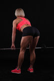 Fitness girl liftings weights Royalty Free Stock Photo