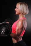Fitness girl liftings weights Stock Images