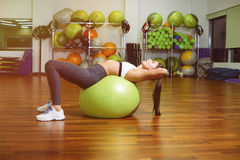 Fitness, girl lying on the ball Stock Images