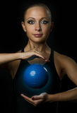 Fitness girl with magic ball Royalty Free Stock Photos